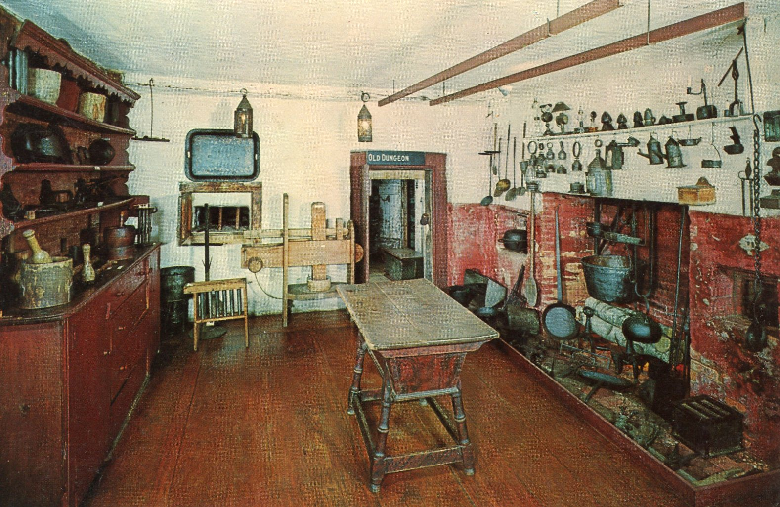 The cluttered kitchen used by the gaol's warden and family.