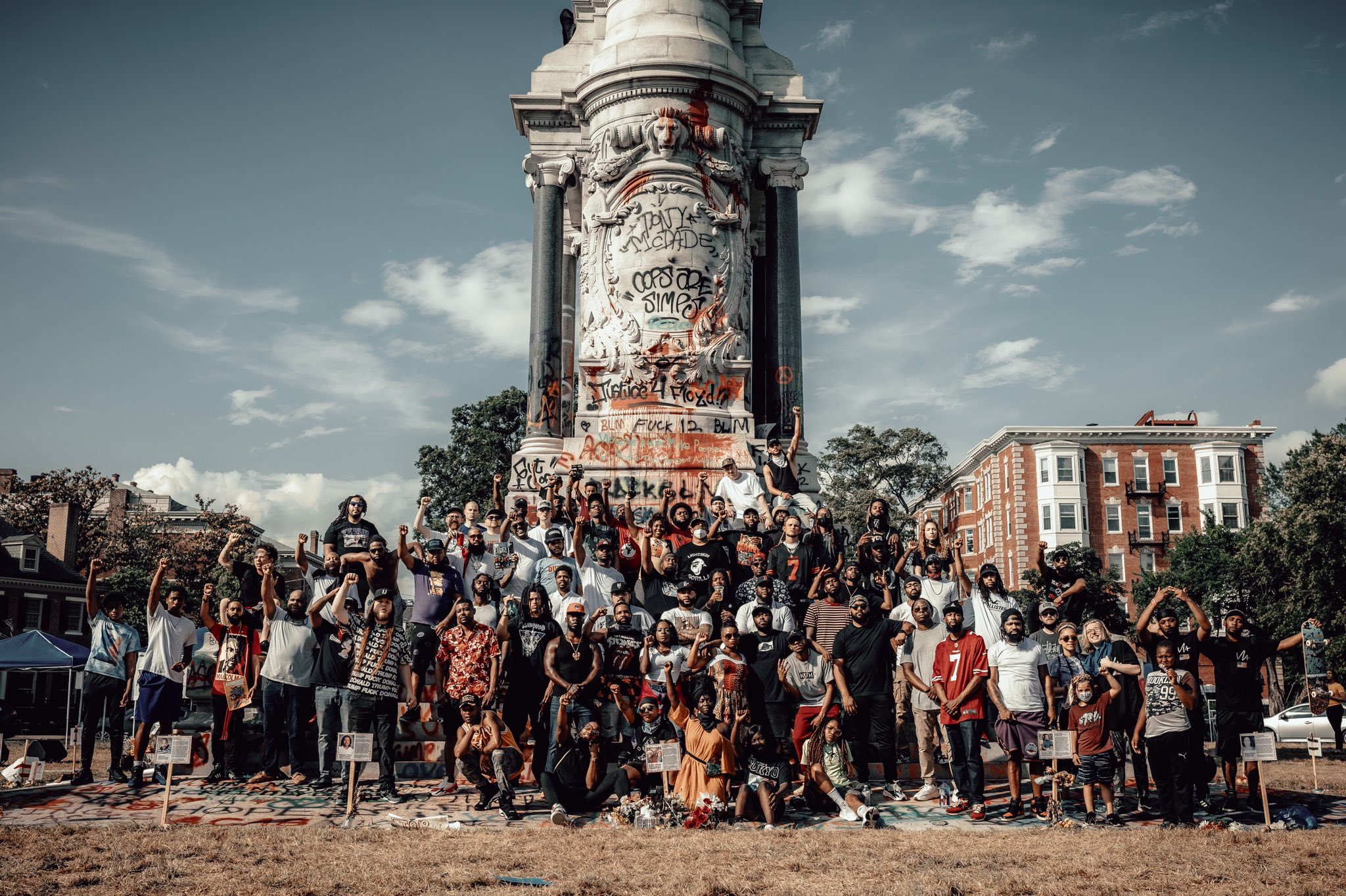 Protestors stand in front of the Lee Monument in June 2020