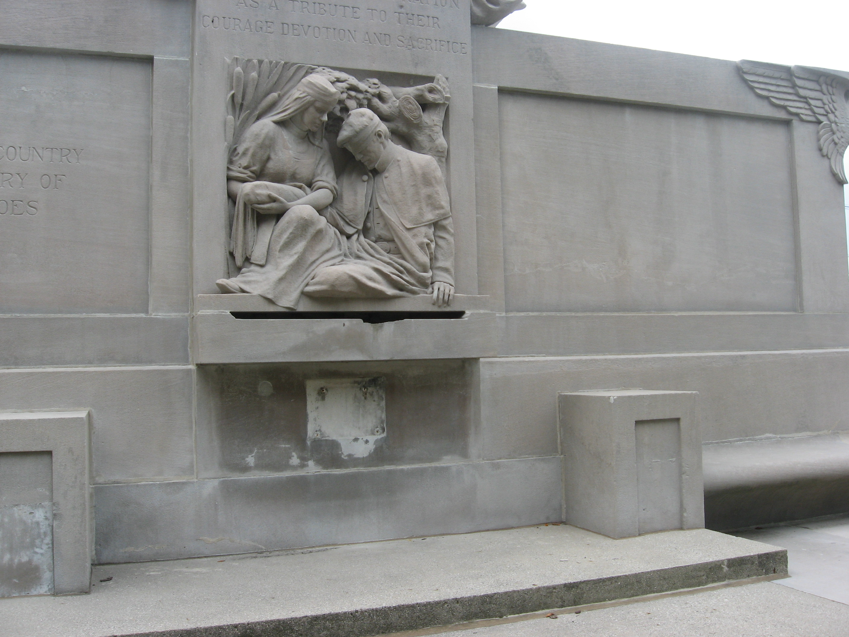 The relief on the back with the statue of the nurse treating a wounded soldier.
