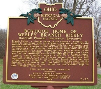 Behind this historical marker lies the boyhood home of Wesley Branch Rickey. The home is located on Duck Run-Otway Road in McDermott, Ohio.