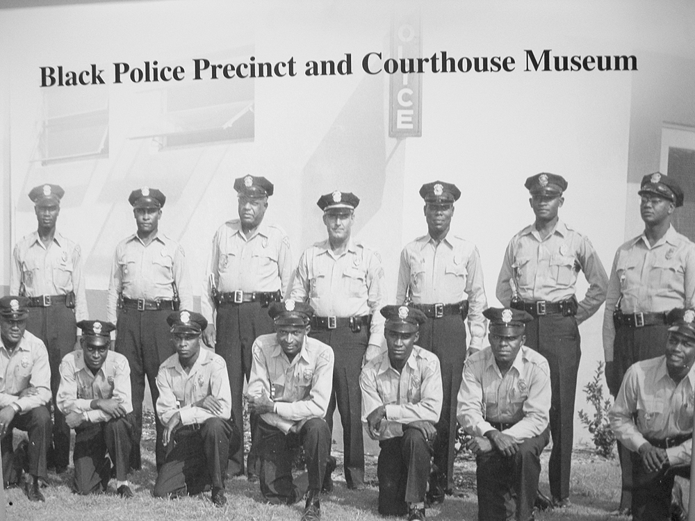 Photo of some of the first officers outside their new precinct house.