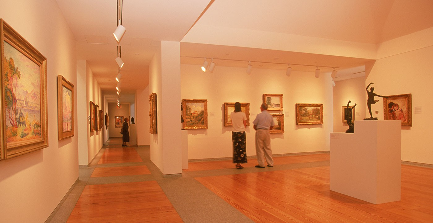 Paintings and Sculptures Within a Museum Gallery