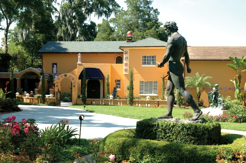 "View of the house from the back and the gardens. The statue is Polasek's ""The Sower,"" one of his most famous statues."