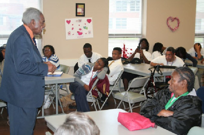 Rev. Lewis with a class in 2012 at the Foundation.