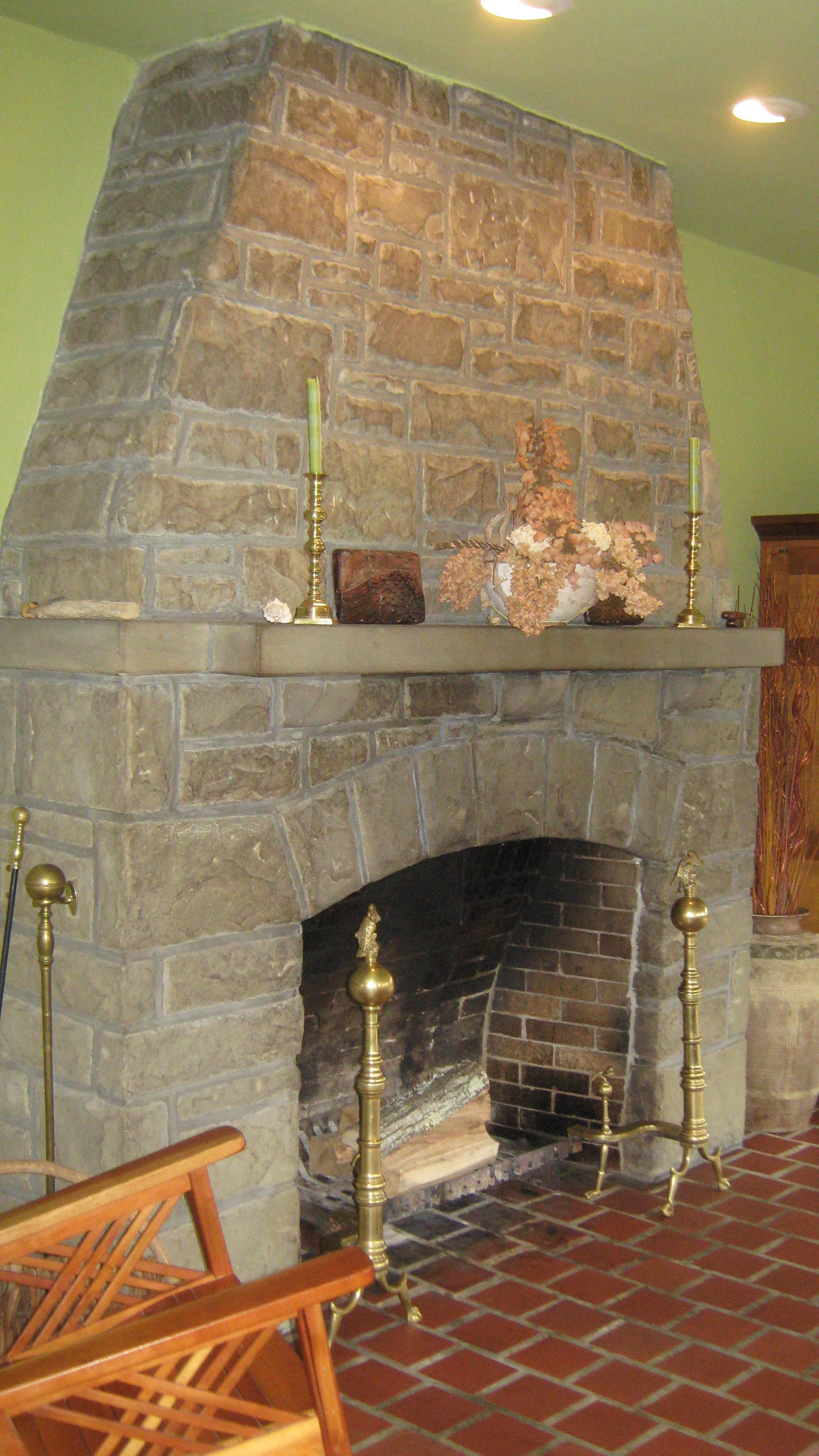 The home's fireplace, part of additions by notable architect Sidney Day in 1923, is still in use.