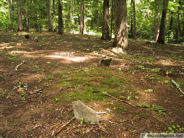 Section of Burial Ground. Rocks jutting out of ground are the 'headstones' for buried slaves.