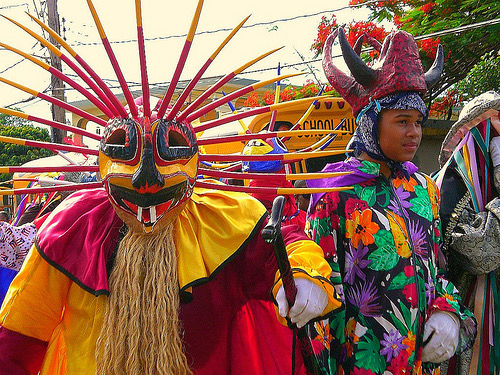 National costumes of the island that are used for the festivals. The masks of the costumes are made of the hard part of coconuts.