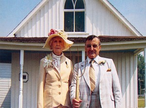 Couple posing for photograph  http://www.americangothichouse.net/chronological-history-of-the-american-gothic-house/