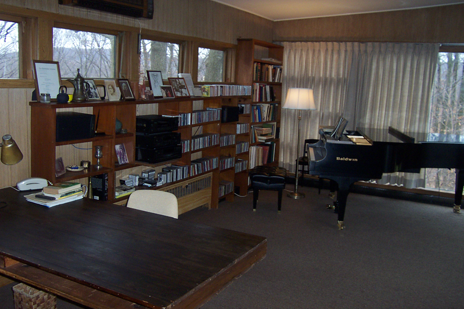 Recent image of Copland's studio, with piano, books, photographs, etc.