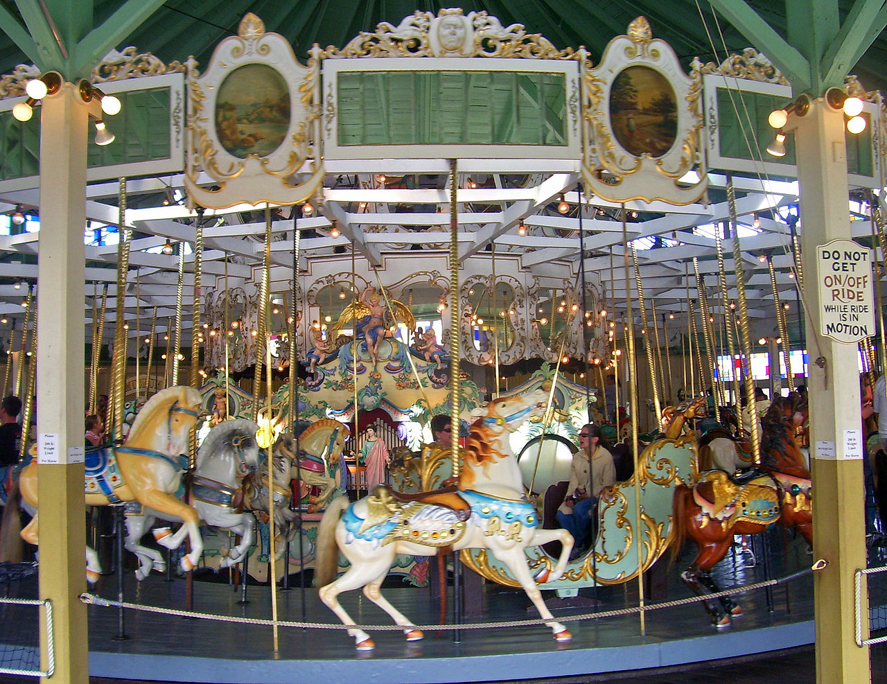 The carousel is 50 feet in diameter and contains 61 horses, one camel, to coaches and two double chariots.