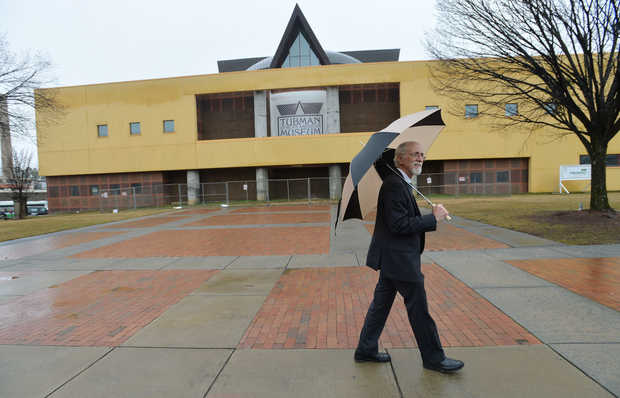 The present day Tubman Museum. Current director Andy Ambrose is pictured walking in front of the building. Photo courtesy of Beau Cabell, The Telegraph (Macon, GA).