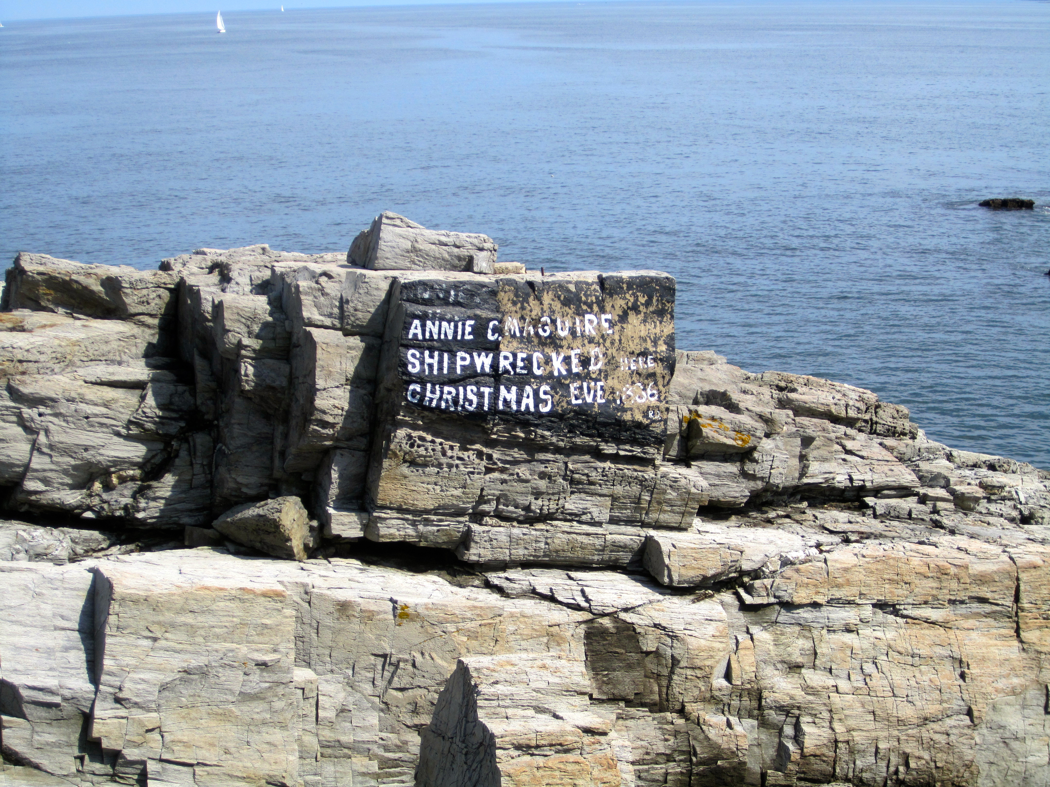 Memorial to the Annie C. Maguire shipwreck in 1886. Written by lighthouse keeper John A. Strout in 1912. Since then, subsequent keepers have maintained the memorial, and its original lettering is seen in this photo.