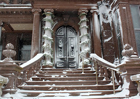Front door of the mansion in winter