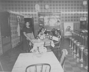 undated photo of Ms. Mayme Martin inside hotel's resturant