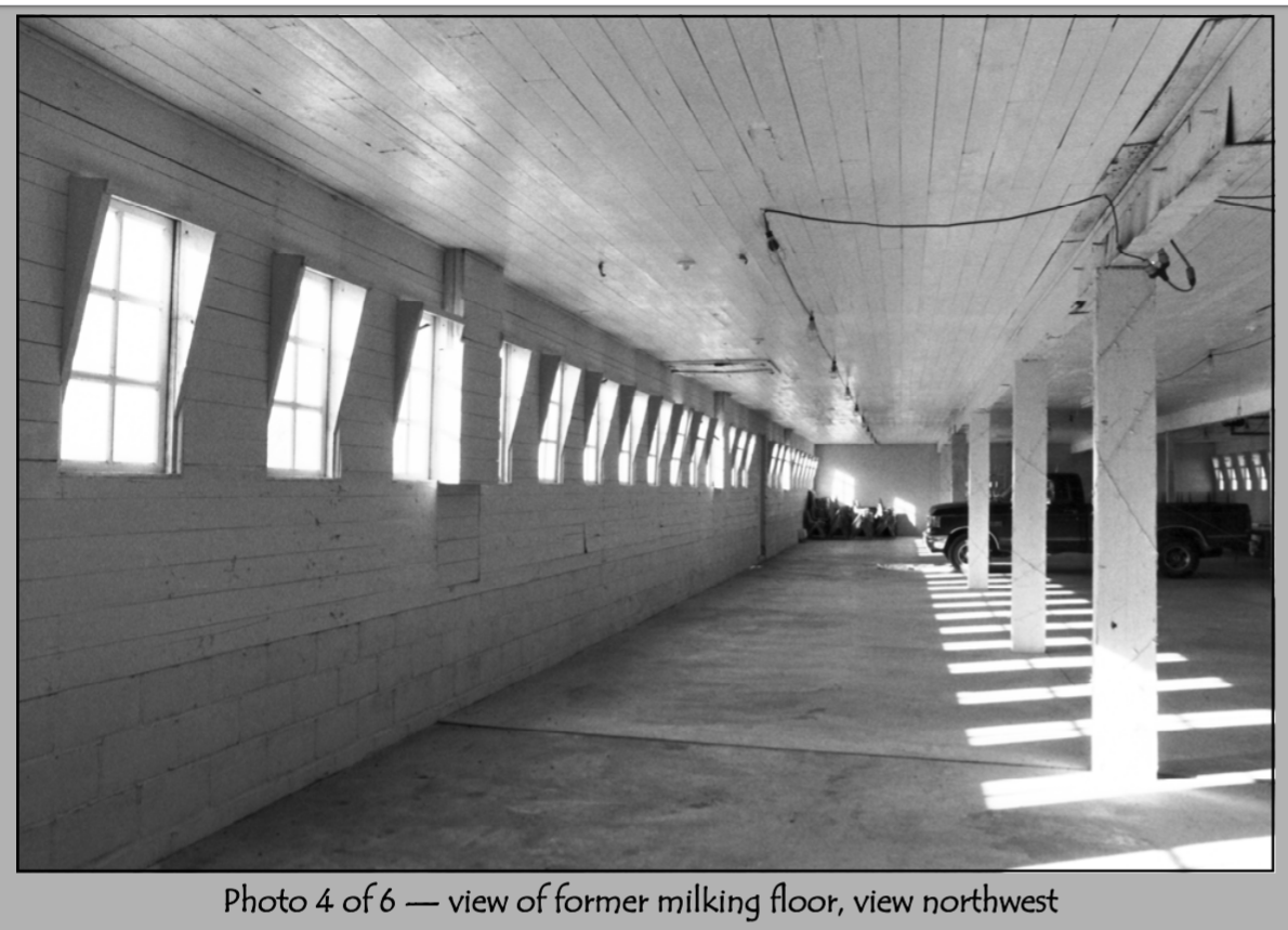 The milking floor in 2001.  It has since been renovated and is used today as a dining space for weddings and private events.  This picture has been modified from its PDF format.
