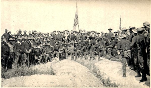 Famed photo of Col. Teddy Roosevelt with American flag atop San Juan Hill. This original photo has the Rough Riders (First Volunteer Calvary), the 10th Calvary and the 3rd US Calvary in the shot.