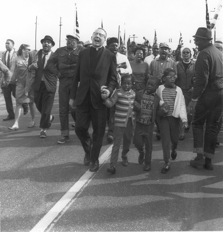Photo from the Jack T. Franklin Exhibit. Marchers singing in unity while marching for Civil Rights.
