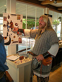 Viking Paul gives  a group tour of the Viking exhibit