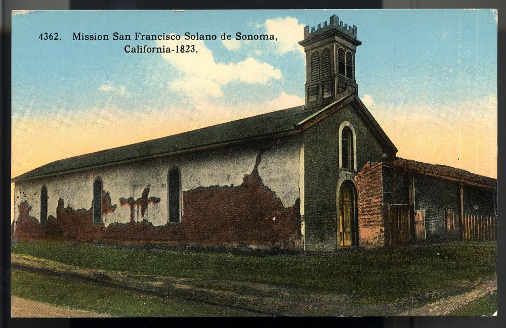 A postcard of the Mission from 1914 shows the neglected state of the whitewashed adobe walls (Smithsonian).