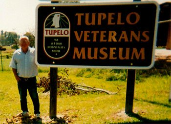 Tony Lute standing next to the museum sign
