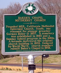 A historical marker located outside the church