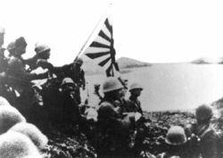 Japanese Occupation Site at Kiska Island; the Japanese raising their flag on the island.