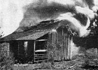 Cabin burning During the Rosewood Massacre.