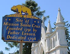 A marker delineates the site of the original mission near the present-day replica.