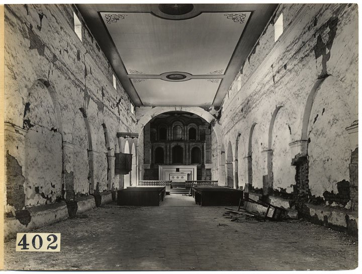 This photograph of the chapel interior from 1908 displays unrepaired damage from the 1906 San Francisco earthquake (CA State Library).