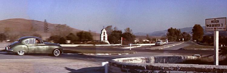 "Scene from VERTIGO. Private Detective John ""Scottie"" Ferguson (Jimmy Stewart) enters the town of San Juan Bautista as he follows a client's oddly behaving wife, Madeleine, played by Kim Novak."