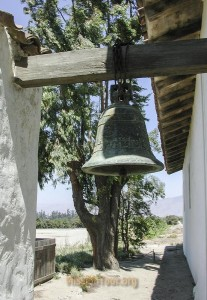 Original Mission Soledad Bell located outside by entrance in 2003. Since then it has been moved inside museum for safety and replaced with a smaller bell.