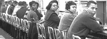 Another photo depicting African American men and women sitting at the lunch counter.