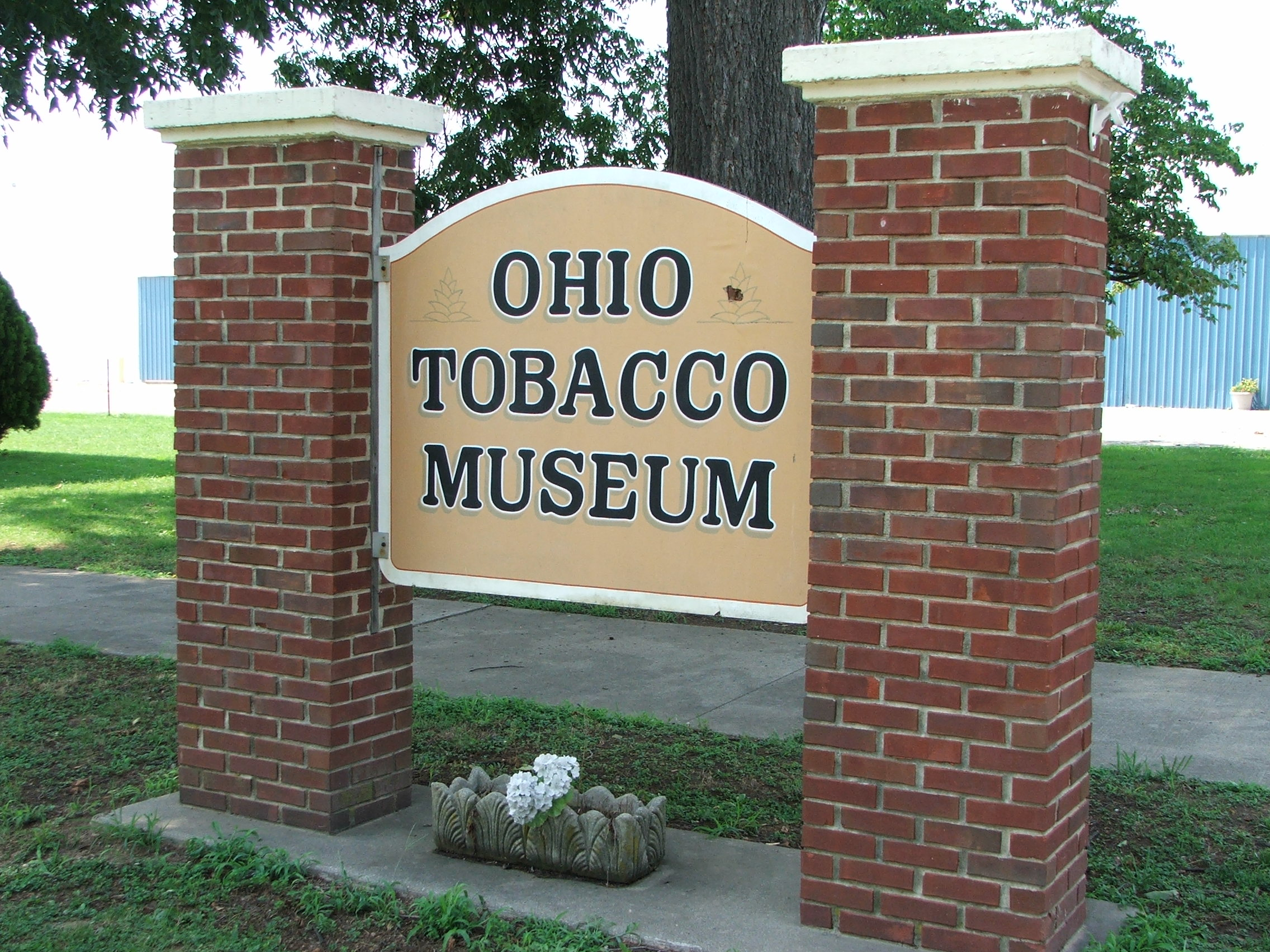 The Ohio Tobacco Museum sign can be seen clearly from the road.