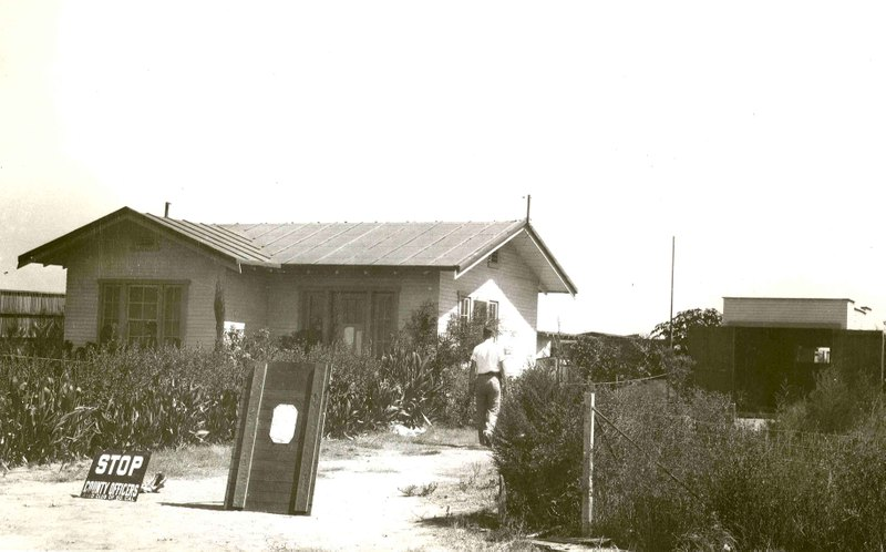Front of chicken farm property in 1928. Stop sign at the time is the equivalent of the police tape used today