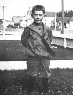 Steinbeck as a child in yard in front of home