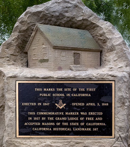 Marker with replica of first public school in California