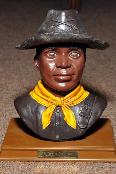 This picture is of the mannequin of a Buffalo Soldier.  The Buffalo Soldiers were responsible for protecting the Western frontier and also building and establishing roads and forts.