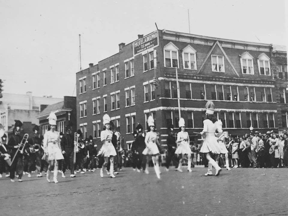A band marches past the Hotel Adelphia
