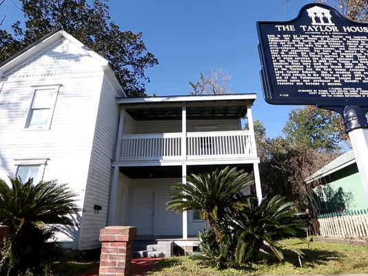 The Taylor House and the plaque that recognizes this a a site listed on the National Register of Historic Places