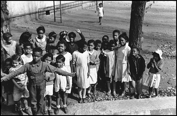 Children playing outside of Omar Douglass School, photographer Ben Shahn, October 1935 