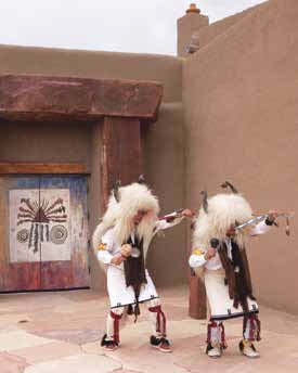 White buffalo dancers at the center