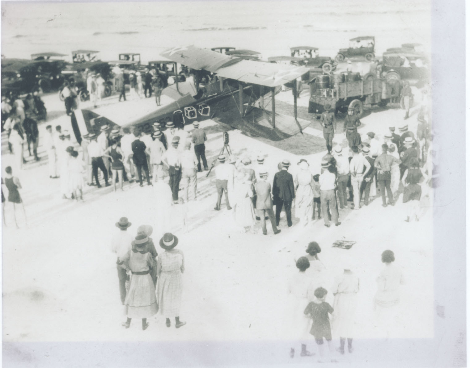 James Doolilttle with his plane and a crowd of spectators at Neptune Beach, Florida on August 6, 1922. This attempt would fail as the crowd forced Doolittle to veer too far toward the ocean, where he encountered wet sand.