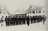 Students in military formation outside of the Calhoun Colored School