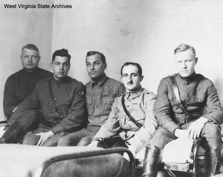 Officers relaxing in barracks in France, circa 1919. From left to right: Capt. Karl C. Pritchard of Huntington, Capt. Cox, Lt. Geistly, Capt. Lalubie, an unnamed French Officer and Lt. Denton. Karl C. Pritchard Collection, West Virginia State Archive