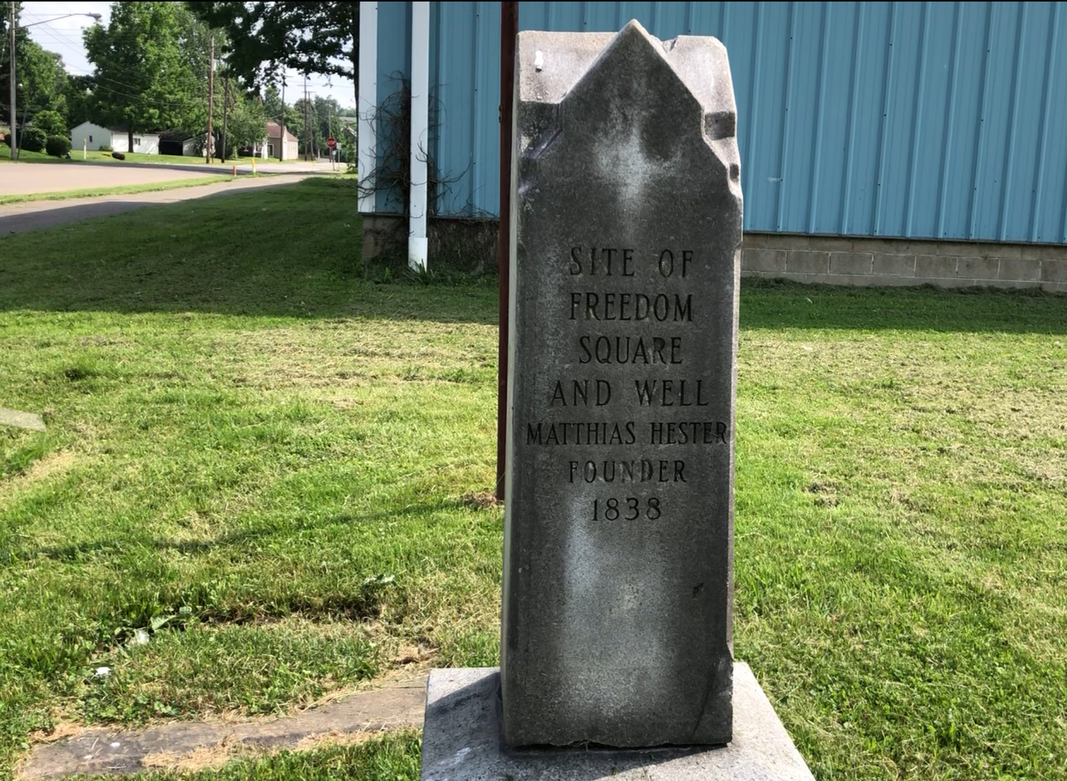 The marker on the southwest corner of Keystone Street and N. Park Avenue commemorates the Freedom village square. The village well can be seen beside the marker.