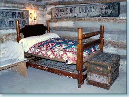 This is a picture of bedroom furnishings in the Pioneer Log Cabin located in Monroe Community Park.