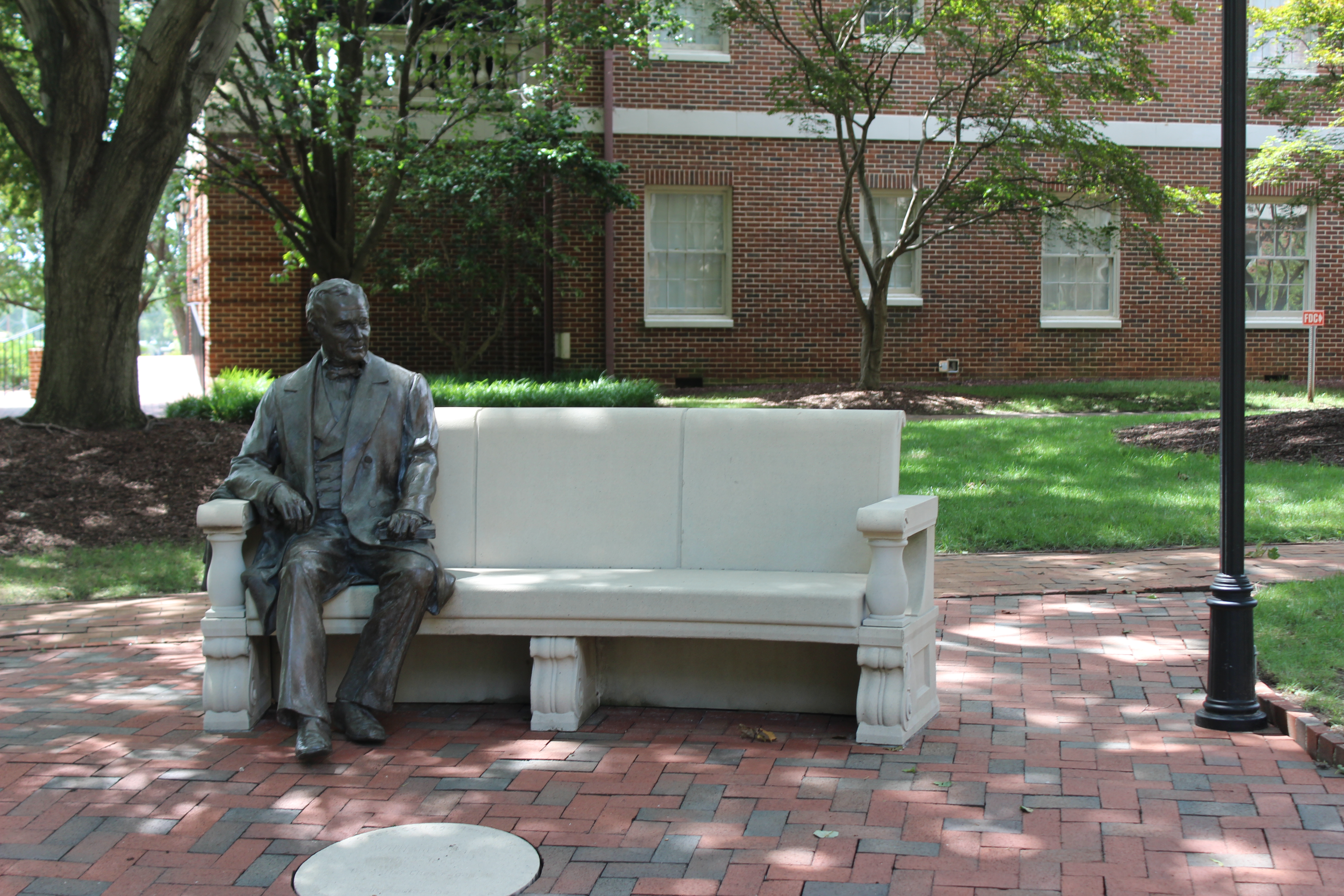 The eponymous William Peace.  Sculpture dedicated in 2007 for the school's sesquicentennial.