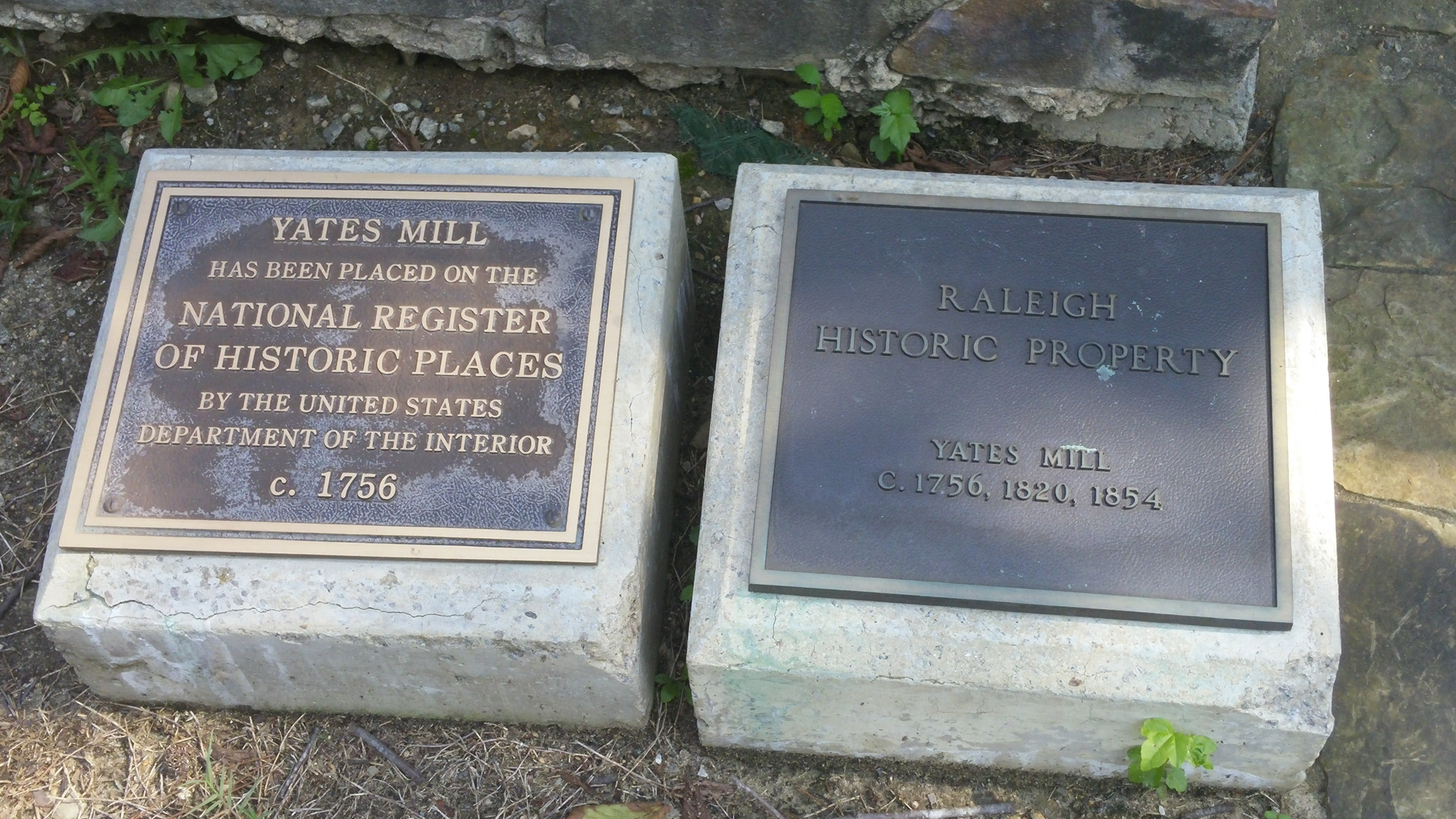 Plaques outside of the mill showing its adoption to the National Register of Historic Places.