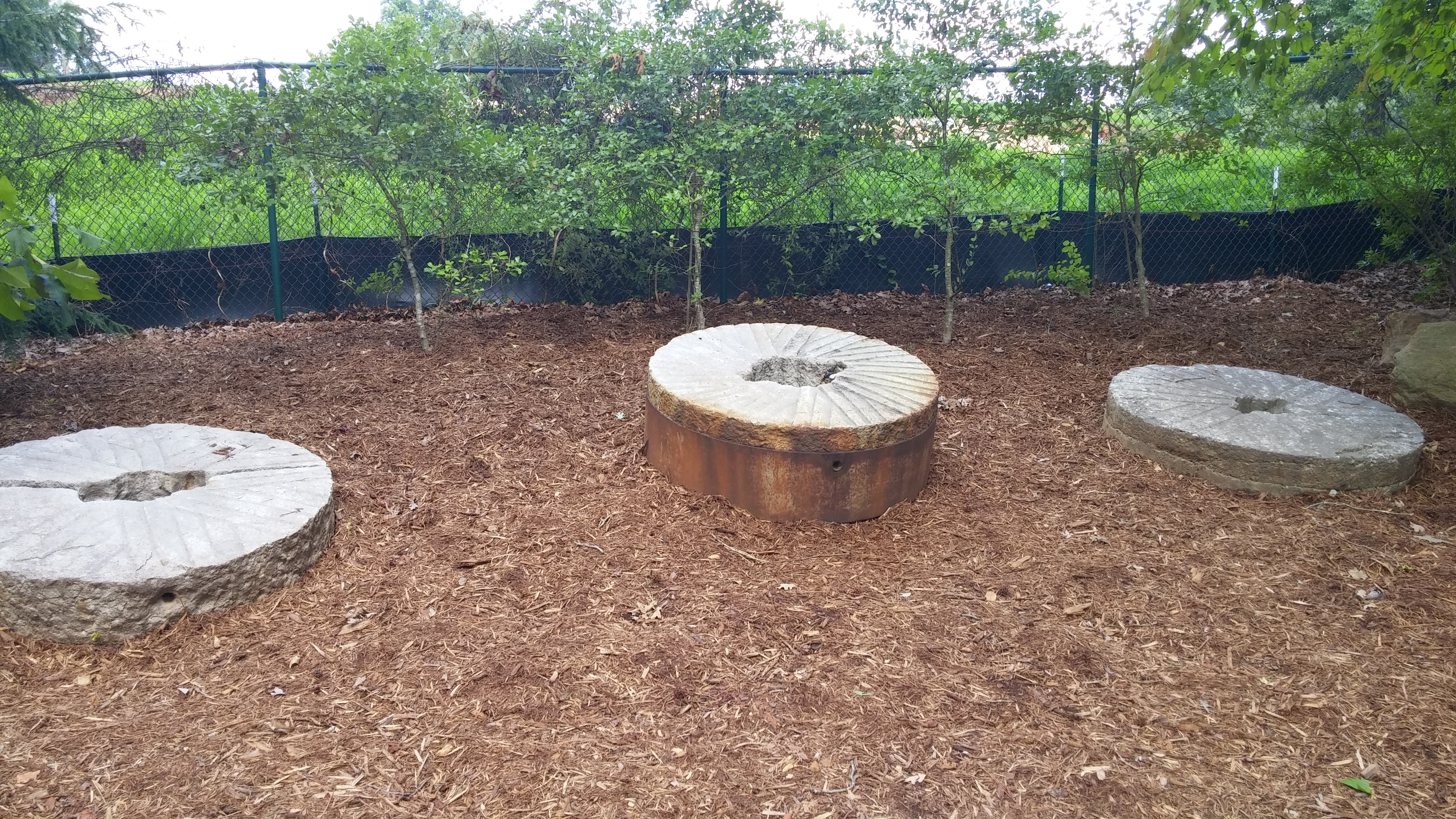 An assortment of millstones once used at Yates Mill.