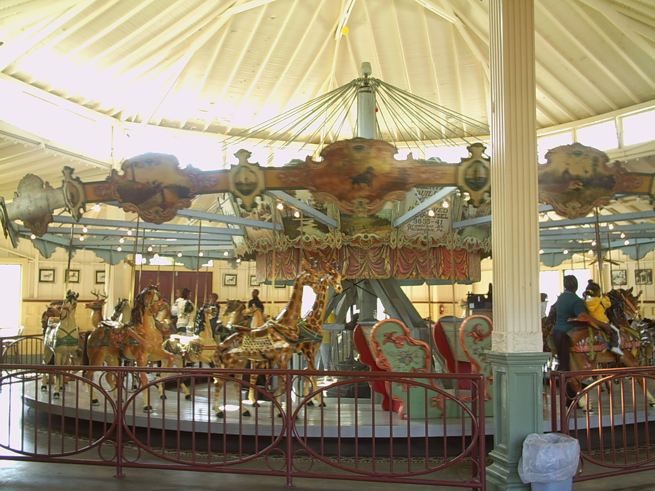 """Highland Park Dentzel Carousel 2"" by Dudemanfellabra at en.wikipedia. Licensed under CC BY-SA 3.0 via Wikimedia Commons - https://commons.wikimedia.org/wiki/File:Highland_Park_Dentzel_Carousel_2.JPG#/media/File:Highland_Park_Dentzel_Carousel_2.JPG"
